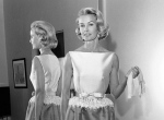 In this April 6, 1962 file photo, socialite-actress Dina Merrill models the gown she will wear at the Academy Awards presentation in Los Angeles. (AP / Harold P. Matosian)