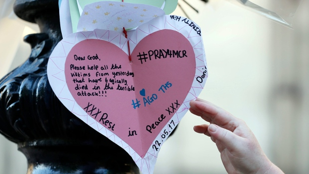 A handwritten note is seen after a vigil in Albert Square, Manchester, England, Tuesday May 23, 2017, the day after the suicide attack at an Ariana Grande concert that left 22 people dead as it ended on Monday night. (AP Photo/Kirsty Wigglesworth)