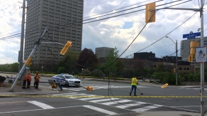 Power lines are seen draping over the roadway after a truck collided into a street pole at the intersection of Scott St. and Parkdale Ave. in Ottawa on May 23, 2017. (Zane Burtnyk/)