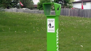 A receptacle meant for dog waste is seen in Lakeshore Optimist Park in Waterloo on Tuesday, May 23, 2017.