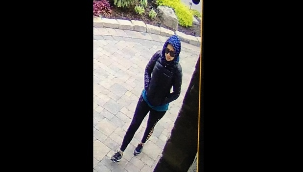 A woman is shown at the front door of a home in Woodbridge in this security camera footage. (debra.dibenedetto /Facebook)