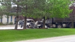 A dump truck hit several parked vehicles after being involved in a fatal crash on Laird Road in Guelph on Tuesday, May 23, 2017. (Scott Clarke / CTV Kitchener)