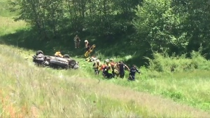 A man was trapped inside of his car as it rolled several times down a steep embankment off the Inland Island Highway near Qualicum Beach Tuesday, May 23, 2017. (CTV Vancouver Island)