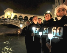 WWF (World Wildlife Fund) activists stand with candles as The Rialto Bridge lights are lit off, in Venice, Italy, Saturday, March 28, 2009. (AP / Luigi Costantini)