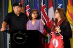 Jocelyn Wabano-Iahtail, right, comforts Shirley Gunner, as John Fox looks on during a news conference regarding the Missing and Murdered Indigenous Women and Girls National Inquiry as Shirley Gunner in Ottawa on Tuesday, May 23, 2017. (Justin Tang / THE CANADIAN PRESS)