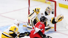 Zack Smith shoots against the Penguins