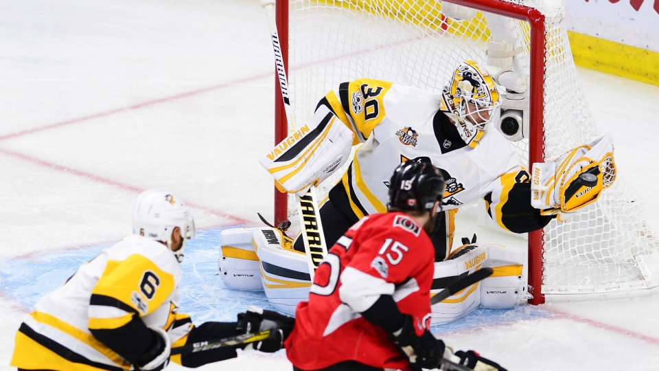 Pittsburgh Penguins goalie Matt Murray makes a save on Ottawa Senators centre Zack Smith as Penguins defenceman Trevor Daley defends during the first period of game six of the Eastern Conference final in the NHL Stanley Cup hockey playoffs in Ottawa on Tuesday, May 23, 2017. (Sean Kilpatrick / THE CANADIAN PRESS)