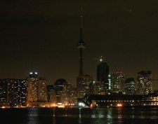 The skyline of Toronto's downtown is dimmed as many of the lights are turned off for Earth Hour on Saturday, March 28, 2009. (Darren Calabrese / THE CANADIAN PRESS)