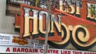 Crews dismantle the Honest Ed's sign in downtown Toronto on Tuesday, May 23, 2017.