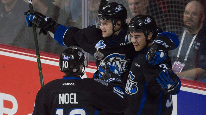 Saint John Sea Dogs left wing Cole Reginato (right) celebrates his goal with teammates centre Nathan Noel and defenceman Bailey Webster during second period Memorial Cup round robin hockey action against the Seattle Thunderbirds in Windsor, Ont. on Tuesday May 23, 2017. (THE CANADIAN PRESS/Adrian Wyld)