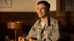 This image released by Netflix shows Topher Grace in a scene from 'War Machine.' (Francois Duhamel/Netflix via AP)