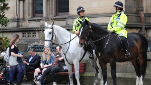 Mounted police on patrol in central Manchester, England Wednesday May 24, 2017. More than 20 people were killed and dozens injured in an explosion following a Ariana Grande concert at the venue late Monday evening. Britons will find armed troops at vital locations Wednesday after the official threat level was raised to its highest point. (AP Photo/Rui Vieira)