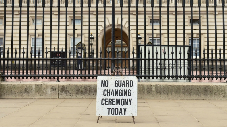 A sign outside Buckingham Palace, London, after the Changing the Guard ceremony at the palace was cancelled on May 24, 2017. (Dominic Lipinski / PA via AP)