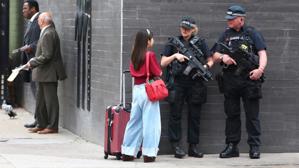 Armed police on Market Street in Manchester, England, on May 24, 2017. (Dave Thompson / AP)