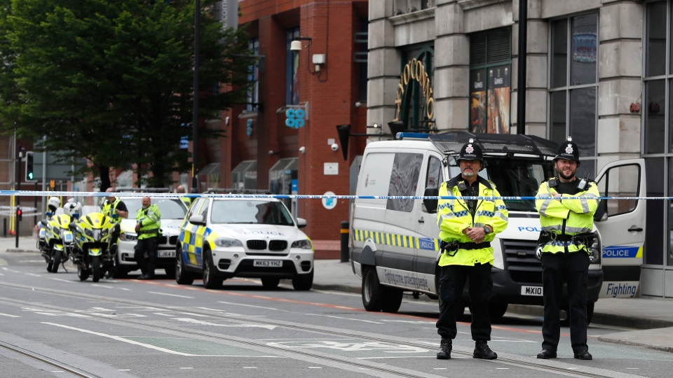 Police keep guard on a cordon in Manchester, England, Wednesday, May 24, 2017. (AP Photo/Kirsty Wigglesworth)