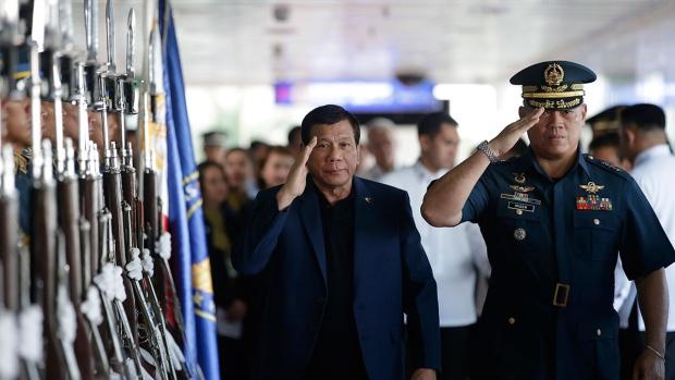 Philippine President Rodrigo Duterte, left, salutes during an arrival honor at Manila's international airport, Philippines, Wednesday, May 24, 2017. (AP / Aaron Favila)