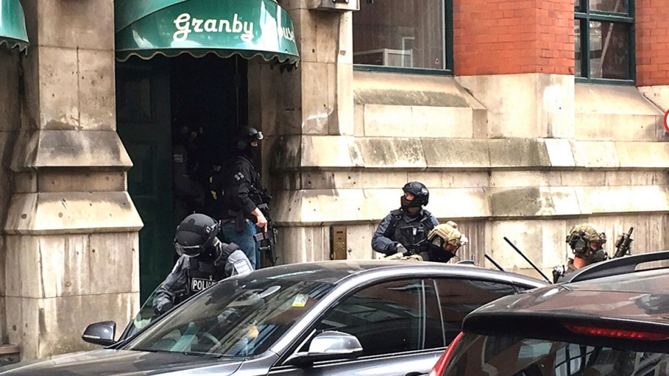Police from the Tactical Aid Unit enter Granby House apartments in Manchester, England, Wednesday, May 24, 2017 in connection to Monday's Manchester explosion. (AP / Louise Bolotin)