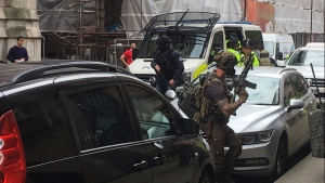 Police from the Tactical Aid Unit prepre to enter Granby House apartments in Manchester, England, Wednesday, May 24, 2017 in connection to Monday's Manchester explosion. (AP / Louise Bolotin)