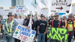 Construction workers form a picket line in front of a construction site Wednesday, May 24, 2017 in Montreal. (Paul Chiasson / THE CANADIAN PRESS)