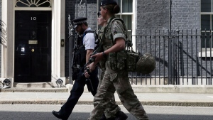 Members of the army join a police officer outside 10 Downing Street in London, Wednesday, May 24, 2017. (AP / Tim Ireland)