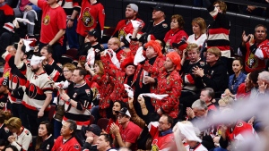 Ottawa Senators fans cheer on their team as they take on the Pittsburgh Penguins during the third period of game six of the Eastern Conference final in the NHL Stanley Cup hockey playoffs in Ottawa on Tuesday, May 23, 2017. (THE CANADIAN PRESS/Sean Kilpatrick)