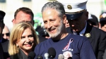 Jon Stewart, accompanied by Rep. Carolyn Maloney, D-N,Y., and New York City first responders speaks during a rally on Capitol Hill in Washington on Sept. 16, 2015. (Lauren Victoria Burke/AP)