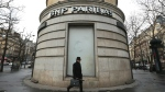 In this Feb. 5, 2013 file photo, a man walks past the French bank BNP Paribas headquarters in Paris. (AP / Jacques Brinon)