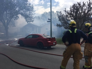 Crews attend to a house fire on Markwell Drive in northwest Regina on Wednesday, May 24, 2017. (CREESON AGECOUTAY/CTV REGINA)