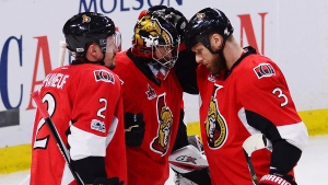 Ottawa Senators defenceman Dion Phaneuf (2), Senators goalie Craig Anderson (41) and Ottawa Senators defenceman Marc Methot (3) celebrate after defeating the Pittsburgh Penguins in game six of the Eastern Conference final in the NHL Stanley Cup hockey playoffs in Ottawa on Tuesday, May 23, 2017. THE CANADIAN PRESS/Sean Kilpatrick