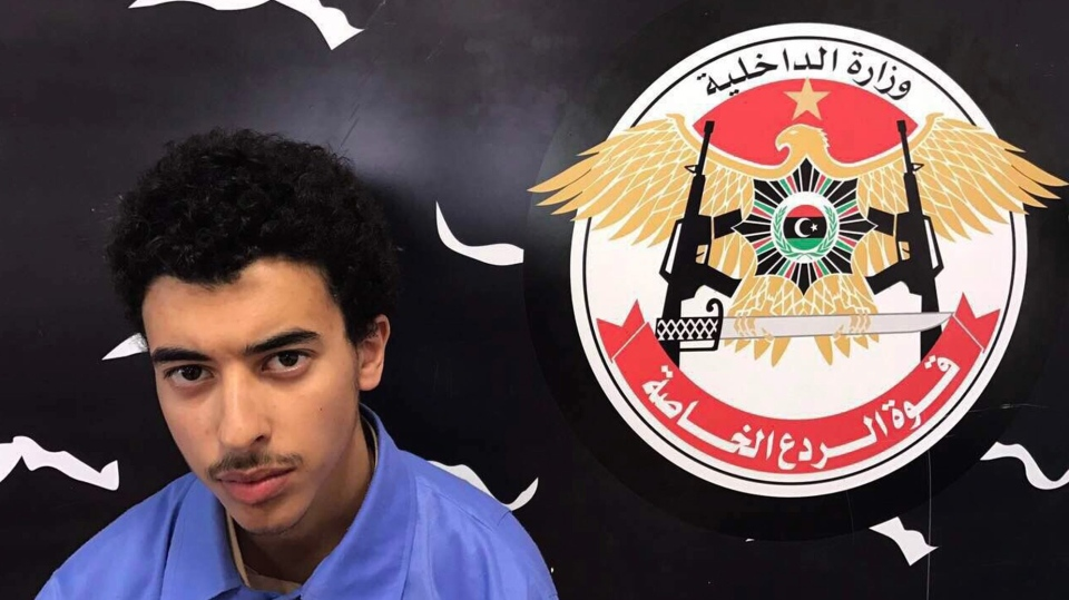 In this Wednesday, May 24, 2017 photo, Hashim Ramadan Abedi appears inside the Tripoli-based Special Deterrent anti-terrorism force unit after his arrest on Tuesday for alleged links to the Islamic State extremist group. Abedi is the brother of Salman Abedi, who has been identified as the man behind the bombing that killed 22 people and wounded scores at an Ariana Grande concert Monday night in Manchester. (Ahmed Bin Salman, Special Deterrent Force via AP)
