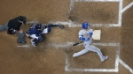 Toronto Blue Jays' Ryan Goins hits a grand slam during the sixth inning of a baseball game against the Milwaukee Brewers Wednesday, May 24, 2017, in Milwaukee. (AP Photo/Morry Gash)