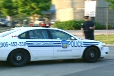 A York Regional Police cruise arrives at Toronto's 31 Division following the police raids on Wednesday, June 13, 2007.