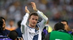 Los Angeles Galaxy's David Beckham, of England, acknowledges the fans as he leaves the field after the team's 3-1 win in the MLS Cup championship soccer match against the Houston Dynamo in Carson, Calif., Saturday, Dec. 1, 2012.  THE CANADIAN PRESS/AP/Jae C. Hong