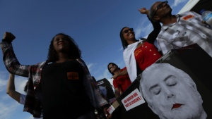 Demonstrators take part in a mock funeral for Brazil's President Michel Temer, during an anti-government protest in Brasilia, Brazil, Wednesday, May 24, 2017. (Eraldo Peres/AP Photo)