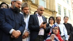 Religious leaders speak to crowds during a vigil at St Ann's square in central Manchester, England Wednesday May 24 2017. (Rui Vieira/AP Photo)