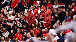Ottawa Senators fans cheer on their team as they take on the Pittsburgh Penguins during the third period of game six of the Eastern Conference final in the NHL Stanley Cup hockey playoffs in Ottawa on Tuesday, May 23, 2017. THE CANADIAN PRESS/Sean Kilpatrick