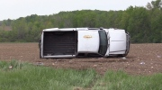 A pickup truck flipped onto its side off of Highway 7 on Wednesday