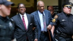 Bill Cosby, second right, leaves with his publicist Andrew Wyatt at the Allegheny County Courthouse after the third day of jury selection in Pittsburgh for his sexual assault case, Wednesday, May 24, 2017. The case is set for trial June 5. (AP Photo/Keith Srakocic)