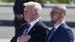 U.S. President Donald Trump and Belgian Prime Minister Charles Michel stand during the playing of the National Anthems during arrival at Melsbroek Military Airport in Melsbroek, Belgium on Wednesday, May 24, 2017. (AP / Geert Vanden Wijngaert)