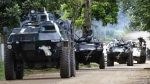 A convoy of APCs head to the site to combat with Muslim militants, three after the latter lay siege in Marawi city in southern Philippines on Thursday, May 25, 2017. (AP / Bullit Marquez)