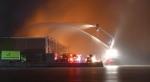 The William Lyon Mackenzie fireboat pumps water onto a six-alarm blaze at a Cherry Street recycling facility on Thursday. (Pascal Marchand)