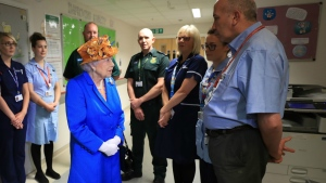 Queen Elizabeth II, centre, speaks with hospital personnel as she visits the Royal Manchester Children's Hospital to meet victims of the terror attack in the city earlier this week and to thank members of staff who treated them on Thursday, May 25, 2017. (Peter Byrne / Pool )