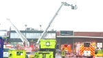 Firefighters at the scene of a fire at a recycling facility in Toronto, Thursday, May 25, 2017.