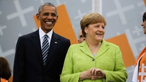 Former U.S. President Barack Obama, left, and German Chancellor Angela Merkel attend a discussion event on democracy and global responsibility at a Protestant conference in Berlin, Germany, Thursday, May 25, 2017, when Germany marks the 500th anniversary of the Reformation. (AP Photo/Markus Schreiber)