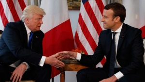 U.S. President Donald Trump shakes hands with French President Emmanuel Macron during a meeting at the U.S. Embassy, Thursday, May 25, 2017, in Brussels. (AP Photo/Evan Vucci)