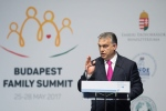 Hungarian Prime Minister Viktor Orban delivers his speech during the Demographic Forum of the Budapest Family Summit conference in Budapest, Hungary, Thursday May 25, 2017. (Szilard Koszticsak/MTI via AP)