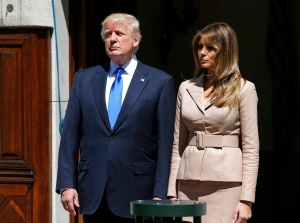 U.S. President Donald Trump and first lady Melania wait for the arrival of French President Emmanuel Macron at the U.S. ambassador's residence in Brussels, Thursday, May 25, 2017. (AP / Peter Dejong, Pool)