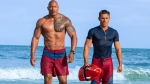 This image released by Paramount Pictures shows Dwayne Johnson as Mitch Buchannon, left, and Zac Efron as Matt Brody in 'Baywatch.' (Frank Masi/Paramount Pictures via AP)