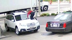 Woman fights off carjacker by jumping on hood