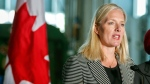 Environment minister Catherine McKenna, left, speaks at an announcement regarding the Pan-Canadian Framework on Clean Growth and Climate Change in Calgary, Alta., Thursday, May 25, 2017. (THE CANADIAN PRESS/Jeff McIntosh)